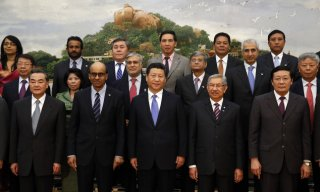 Chinese President Xi Jinping, front center, presents using the various other government frontrunners and the visitors which attended the signing ceremony of this Asian Infrastruct...